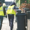 Image of household waste bins being collected