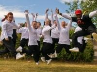 Dance troupe jumping at Party in the Park, Wellingborough, 2010.